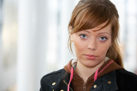Teenage girl in modern building, front view