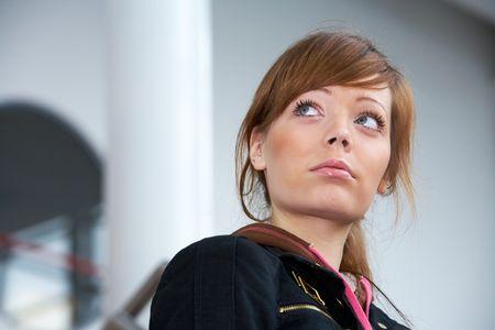 Teenage girl in modern building, serious Stock Photo - 3574232