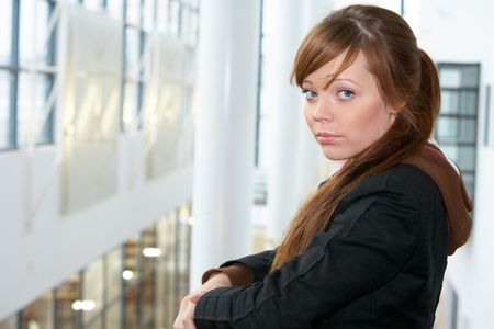 Teenage girl in modern building, looking at camera Stock Photo - 3574289