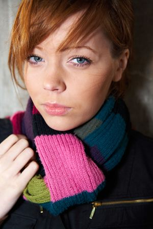 Teenage girl portrait, wearing scarf, looking at camera photo