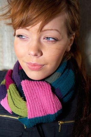 Teenage girl portrait, wearing scarf, looking away photo