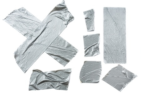 Strips of duct tape isolated on white background photo