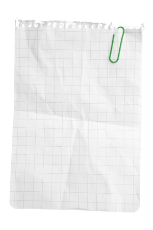 Single notepad sheet with paper clip isolated on white bacground with clipping path photo