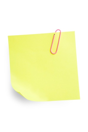 Yellow sticky note attached with paperclip isolated on white background with shadow