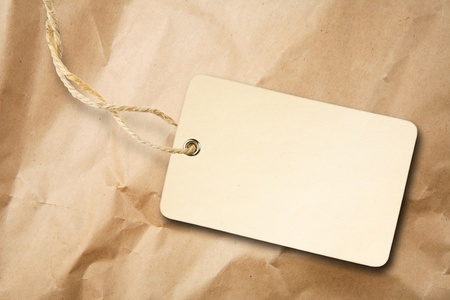 Blank packaging label with cotton string on crumpled brown paper Stock Photo - 8736857