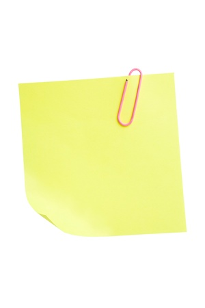 Yellow sticky note attached with paperclip isolated on white background  Stock Photo - 8736778