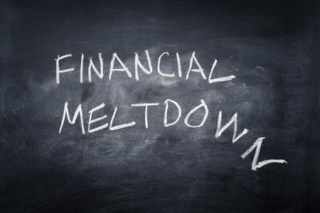meltdown: Financial meltdown written on a chalkboard Stock Photo