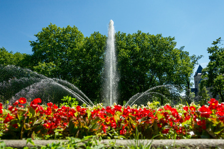 Beautiful fountain in the city of Poznan Surrounded by an abundance of colorful flower beds. Poland Stock fotó
