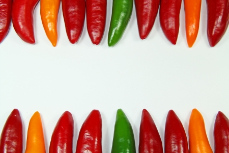 Background with colored chili peppers photo