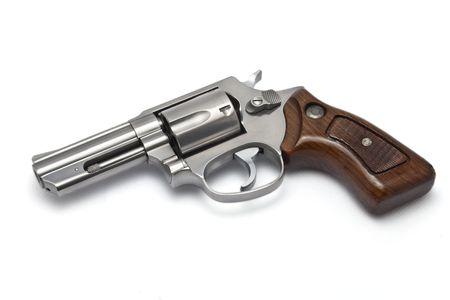 Silver revolver on white background photo