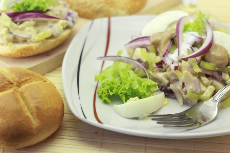 Egg salad with mustard and mayonnaise on a bun Stock Photo