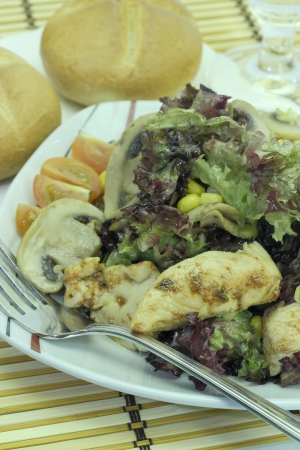 Vegetable salad with chicken and mushrooms