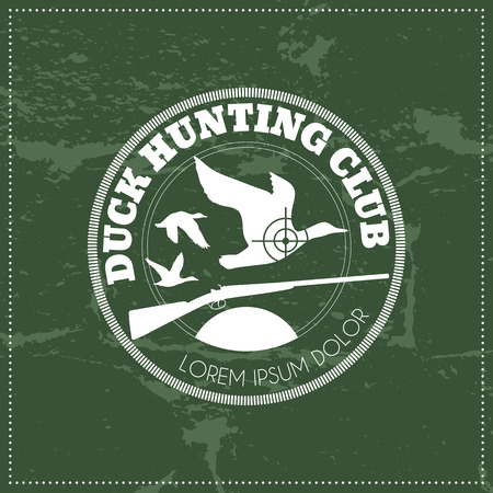 duck hunting: Vector hunting club emblem with a wild duck and a shotgun. White monochrome label on a dark green grunge background. Easy to edit colors