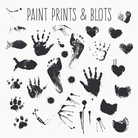 collection of paint prints - footsteps, pawprints, palms, shapes of hearts, cat muzzles, fish, inkblots, stains, smears. Monochrome design elements