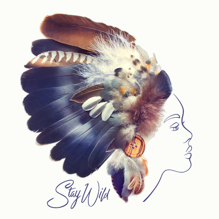 Fashion portrait of beautiful woman with Native American Indian Feather Headdress made with real feathers. Creative tribal illustration.
