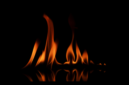 orange inferno: Aabstracts Fire texture Isolated on black backgrounds Stock Photo