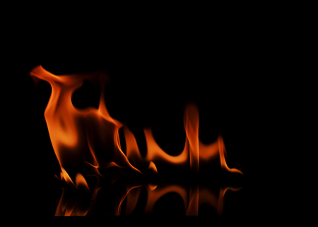 orange inferno: Abstracts fire texture on black backgrounds Stock Photo
