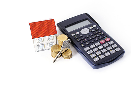 loans: Mortgage loans concept with key and coins stack, paper house and calculator