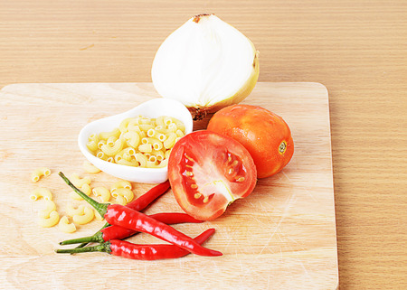 close uo: Close uo of tomatoes, red pepper, Onion, Macaroni for clean foods concept