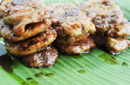 stab: Close up of Delicious grilled pork mooping thai local food on banana green leaf Stock Photo