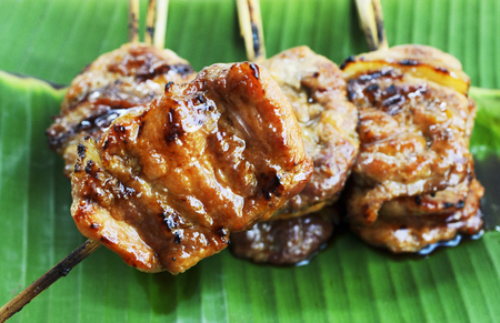 Grilled pork or mooping thai local food on banana green leaf Stock Photo