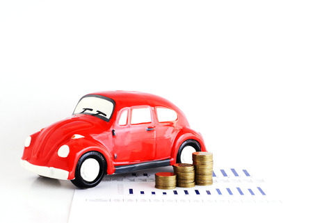 Red Car bank and coins stack for car loans concept Stock Photo