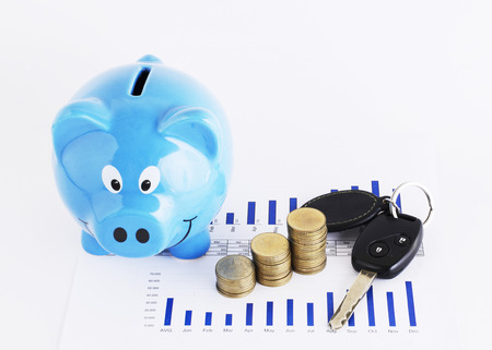 financial item: Car key and coins stack and piggy bank for Loans money concept Stock Photo