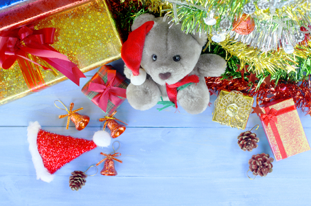 Christmas decorations with teedy doll and santa hat and gift box backgrounds above