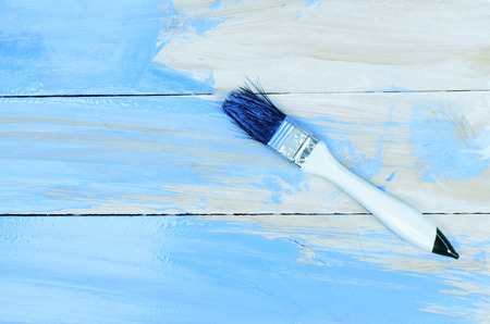 Wood back drop  and brushes bu with blue pastel color backgrounds Stock Photo