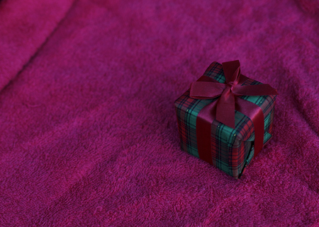 Gift box on red carpet backgrounds for chirstmas themes concept Stock Photo