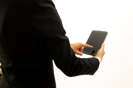 Close up of Business man using tablet on white backgrounds for copy space. Place for your text Banco de Imagens