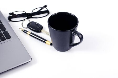 Coffee cups with car key and fountain pen adn eyeglasses on white backgrounds for Life technology concept with copy space for text