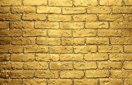 background gold brick wall with shimmer 免版税图像