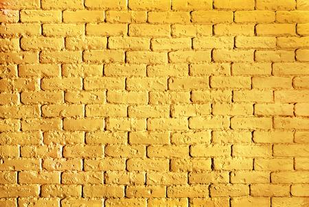 キラキラ テクスチャで背景金レンガの壁 写真素材