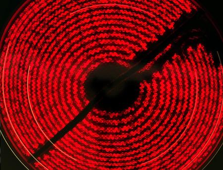 stove top: Ceramic Stove Top - hot  red spiral on black Stock Photo