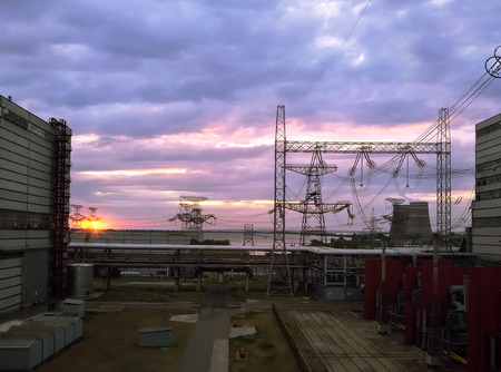 telegraph: High voltage power lines at sunset on the power plant Stock Photo