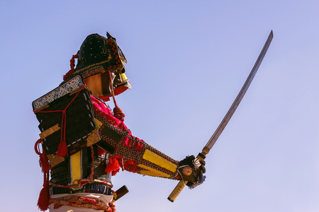 samurai sword: Samurai in ancient armor, with a sword ready to attack