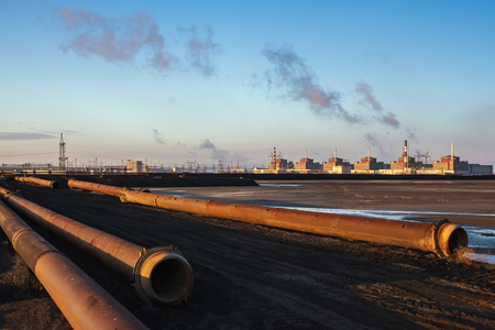 npp: the biggest Zaporizhzhya nuclear power plant in Europe, against the background of the industrial landscape Stock Photo