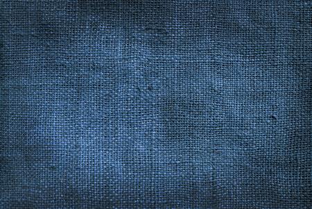 古い背景の黄麻布のリネン デニム