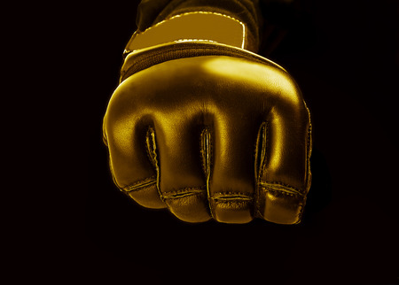 mma: Gold Glove for the martial arts, mma on a  black background Stock Photo