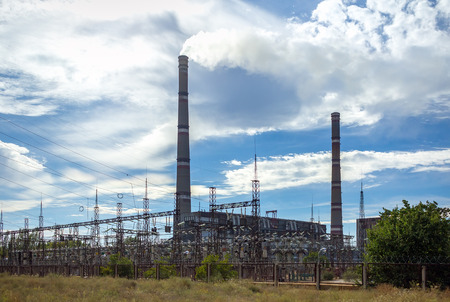 polluting: Pipe thermal power station polluting smoke. Power Plant Stock Photo