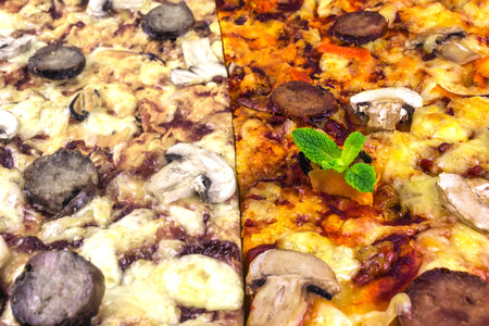 portions: handmade pizza with salami and mushrooms, fried portions close-up