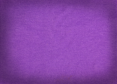 tejido de lana: knitted woolen fabric purple color for the background. wool woven texture. Foto de archivo