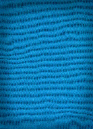 tejido de lana: knitted woolen fabric blue color for the background. wool woven texture.