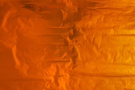 bronze background: horizontal sheet of crumpled gold foil. bronze background.