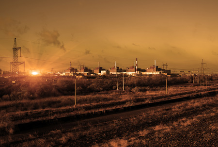 thermal pollution: Nuclear energy and pollution. Nuclear Power Station in sepia color.