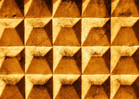 unkept: cracked gold slab with rhombus texture. Grunge background. Stock Photo
