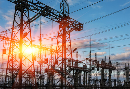 high-voltage  power lines at sunset. electricity distribution station . high voltage electric transmission tower.