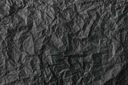 Crumpled paper background vignette. texture of crumpled black paper.