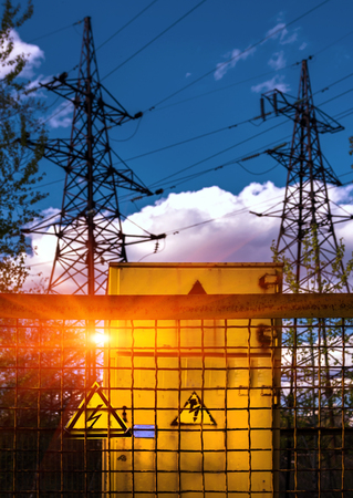 power cables: Sign dangerously high voltage on the background of high-voltage lines at sunset